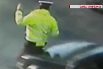 Momentul în care un polițist din Oradea e luat pe capotă de un șofer. Explicația acestuia