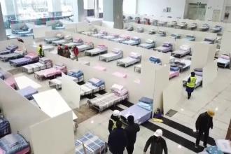 Măsuri disperate în China. Dezinfectant împrăştiat cu drona, spitale păzite de armată