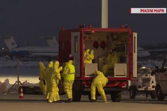 Cei 2 români evacuați din focarul epidemiei de coronavirus, aduşi în ţară într-o cameră ermetică