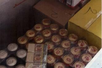 Român anchetat în UK după ce a vândut vin vărsat și țuică în biberoane