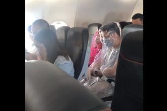 Metoda aleasă de doi pasageri pentru a nu contracta coronavirusul în avion
