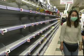 Scene de groază în Italia. Oamenii se bat pe mâncare și merg cu valizele după provizii