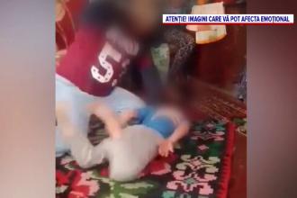 Un nou caz de violenta starneste revolta. Un barbat din Suceava, filmat in timp ce isi bate cu cruzime copilul de 8 ani