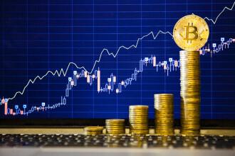Bitcoin a atins un nou nivel record. Cât costă acum cea mai scumpă criptomonedă din lume