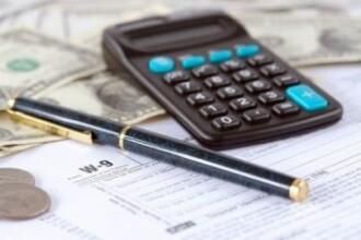 Clientii BCR pot achita impozitele pentru case, terenuri si masini prin internet si telefon