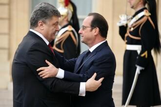Hollande, Merkel si Porosenko au discutat despre criza din Ucraina, inainte de Marsul de solidaritate din Paris