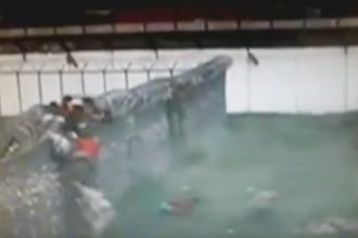 Evadare in masa dintr-o inchisoare din Brazilia dupa ce au aruncat in aer un zid. Momentul, surprins de camere