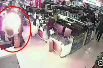 Explozie într-un magazin de telefoane, după ce un bărbat a muşcat dintr-o baterie