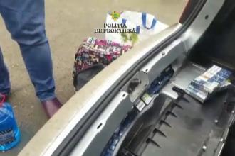Țigări de 78.000 de lei, confiscate de polițiști. Pachetele erau ascunse în bara mașinii