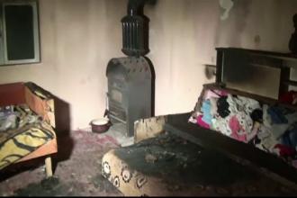 O fetiță de un an a murit și fratele de 2 ani e în stare gravă, după un incendiu