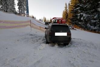 FOTO. Un șofer cu BMW a rămas înzăpezit după ce a intrat cu mașina pe o pârtie de schi din Sibiu