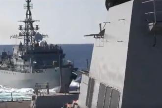 """Momentul în care o navă rusească se apropie """"agresiv"""" de un distrugător al SUA. VIDEO"""