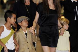 Angelina Jolie si Brad Pitt vor sa adopte un copil din Haiti