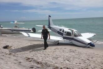 Un tata din Statele Unite a murit iar fiica lui este in stare grava dupa ce un avion usor s-a prabusit peste ei, pe o plaja