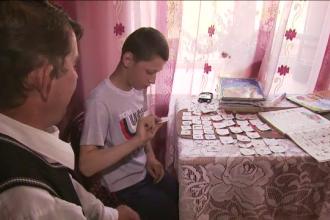 Un medic l-a nenorocit, iar profesorul nu l-a invatat nici alfabetul. La 12 ani, Mihaita stie doar ca D vine de la Delfin