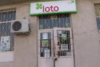 Un angajat de la o spalatorie auto a castigat premiul de 4 milioane de euro la LOTO. Seful sau a venit cu el la Bucuresti