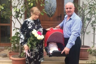 Parintii arhitectului Andrei Buca, mort in incendiul din Colectiv, si-au botezat fetita de 3 luni.