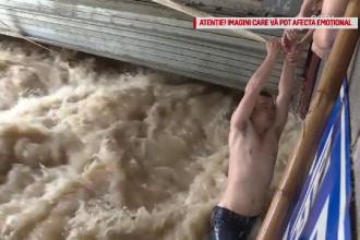 Inundatii uriase in sudul Chinei. Doi barbati surprinsi de ape au fost salvati de localnici dintr-o parcare subterana