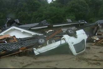 Sudul Japoniei este acoperit de ape. Mii de localnici refuza sa-si paraseasca locuintele si risca sa se inece