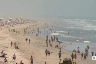 Arsurile solare pot duce la cancer de piele. Evitați plaja la ora prânzului și aplicați cremă