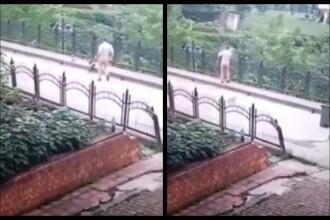 Momentul în care un angajat mătură un cățel de pe stradă și-l aruncă de pe pod. VIDEO