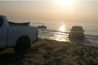 Imagini incredibile pe litoral: SUV blocat în mare. Tânărul care a filmat scena, amenințat