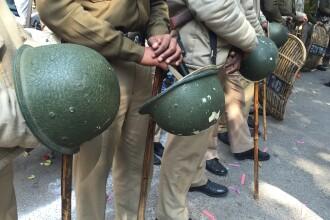 Polițiști, arestați, după ce au ucis 2 persoane, pentru că și-au ținut magazinul deschis