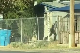 VIDEO. Un polițist a intrat într-o casă în flăcări. A salvat un copil de 8 ani și i-a promis un cadou special