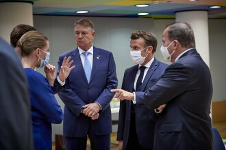 Iohannis, fotografiat fără mască la summit-ul UE. Explicațiile Administrației Prezidențiale