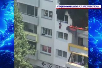Scene dramatice în timpul unui incendiu. Doi copii, salvați dintr-un bloc cuprins de flăcări, după ce s-au aruncat în gol