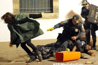 Confruntari violente intre manifestanti si politie la Rio de Janeiro. Avertismente cu gloante reale