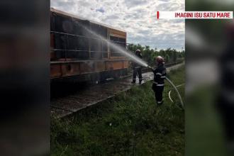 Locomotiva unui tren de persoane a luat foc in timpul mersului, langa Satu Mare. Cei 30 de pasageri au fost salvati la timp