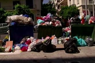 Turistii care vin in Atena, Salonic si Corfu, intampinati de gramezi de gunoaie. Angajatii de la salubritate sunt in greva