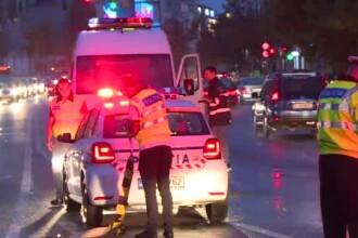 Poliţistă luată pe capotă de un taximetrist, în Capitală. Şoferul dă vina pe ea