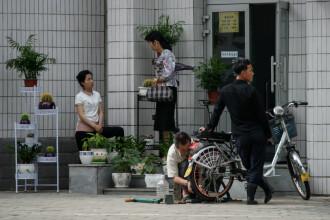 Cât trebuie să dea mită nord-coreenii care vor să trăiască în marile orașe