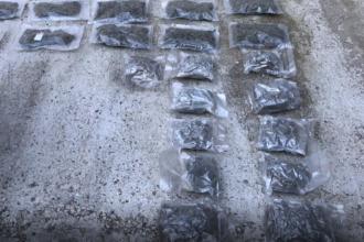 Reţea de trafic de droguri, descoperită de DIICOT. Câte kilograme de canabis aveau în casă