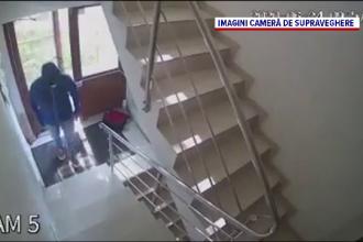 Un individ camuflat, surprins de camerele de supraveghere încercând ușile apartamentelor, în Craiova