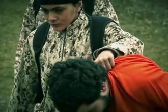 Statul Islamic a filmat o noua executie. Un baiat de 10 ani a impuscat in cap un spion israelian. VIDEO