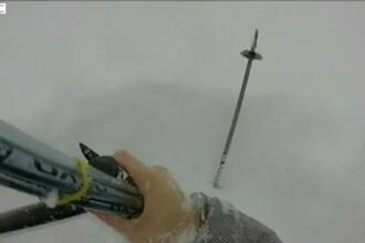 Un turist a stat ingropat in zapada aproape o ora, dar a fost salvat datorita unui bat de schi. Totul a fost filmat