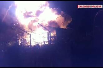 Un depozit cu tone de fan si sute de litri de combustibil a ars ca o torta. Pompierii, pusi in pericol de o explozie violenta