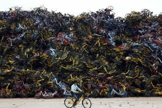 Imagini impresionante cu bicicletele abandonate de pe străzile din China