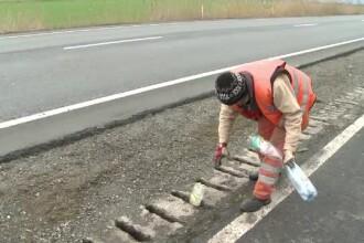 Obiceiul românilor de a arunca resturi pe geam a umplut de gunoi cea mai aglomerată șosea