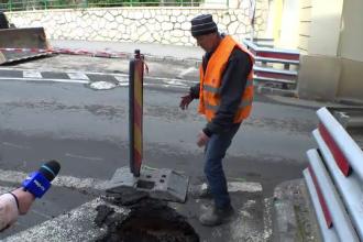 Muncitor, la un pas să fie strivit între un utilaj și pereții unei gropi din asfalt