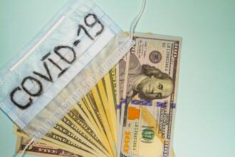 Măsuri extreme de teama coronavirusului. SUA bagă dolarii în carantină, Coreenii ard bancnotele