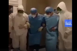 De ce dansează medicii din Iran în fața bolnavilor de coronavirus. VIDEO