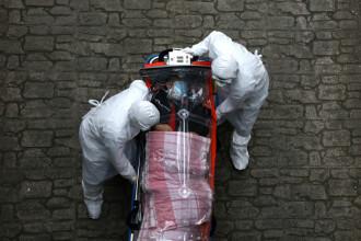 Experţi din Wuhan recomandă italienilor măsuri mai stricte pentru a ţine sub control epidemia