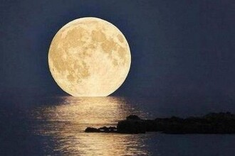 Super-luna in imagini. Cele mai spectaculoase fotografii realizate in momentul de apropiere maxima