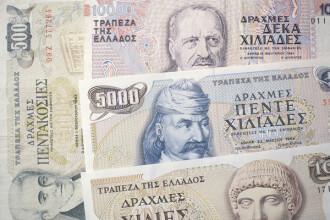 Europa asteapta noua criza. Cresc actiunile companiei ce ar urma sa tipareasca drahme pentru greci