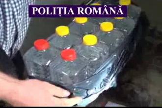 Peste 100 de litri de alcool descoperiti in casa unei femei din Arad au fost confiscati de politisti