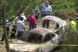Doua cadavre carbonizate, gasite intr-o masina incendiata. Unul dintre ele era in portbagaj